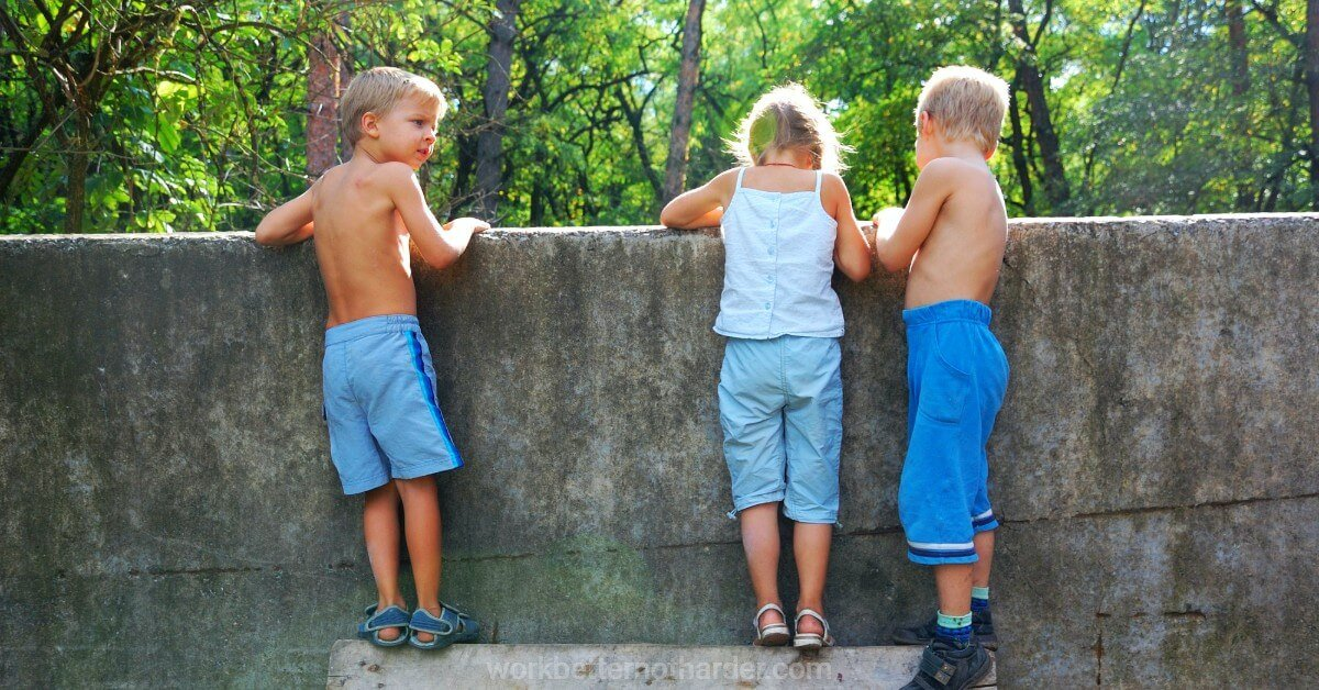 children looking over a wall
